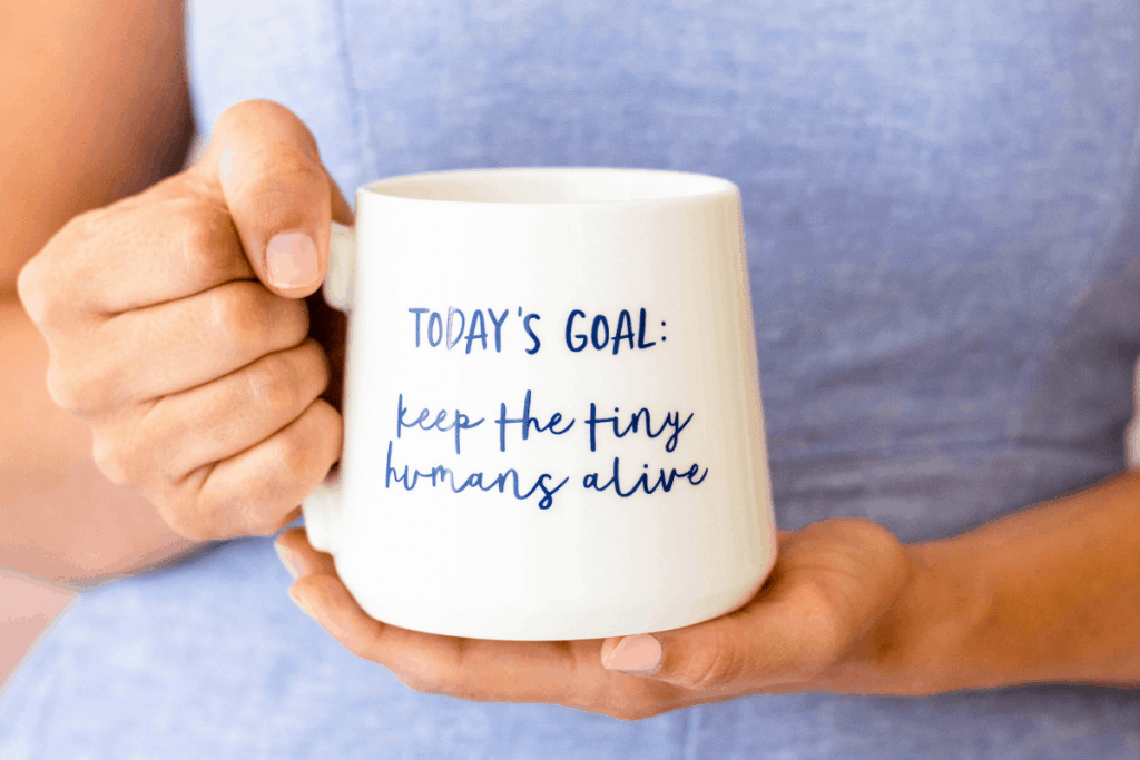 "coffee cup that says, ""keep the tiny humans alive"""